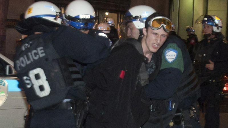 Police arrest a protester during a demonstration against tuition fee hikes in Montreal on Tuesday, May 22, 2012. THE CANADIAN PRESS/Ryan Remiorz