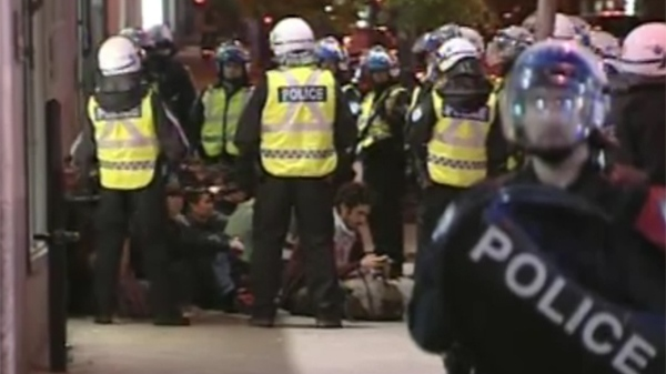 Police arrested at least 100 protesters Tuesday after demonstrations turned violent. (May 22, 2012)