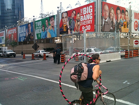 A cyclist ignores the significant police presence at John Street as she travels west on Wellington St. on Monday, June 21, 2010. (Bill Doskoch/ctvtoronto.ca)