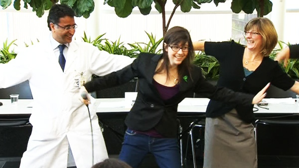 Double-lung transplant recipient Helene Campbell dances with her parents and doctors in Toronto on Thursday, May 24, 2012.