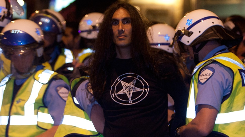 Police arrest a protester after a march against tuition fee hikes Thursday, May 24, 2012 in Montreal. (Ryan Remiorz / THE CANADIAN PRESS)