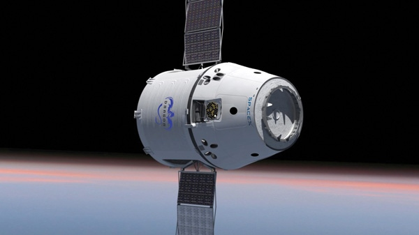 This computer generated image provided by SpaceX shows their Dragon spacecraft with solar panels deployed. The world's first private supply ship flew tantalizingly close to the International Space Station on Thursday, May 24, 2012 but did not stop, completing a critical test in advance of the actual docking scheduled for Friday, May 25, 2012. (SpaceX)