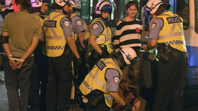 Police arrest protesters after a march against tuition fee hikes Thursday, May 24, 2012 in Montreal.THE CANADIAN PRESS/Ryan Remiorz