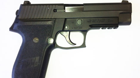 A Sig Sauer P226 pistol similar to one reported missing by the Vancouver Police Department is shown in a handout photo.