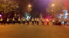 A line of police officers block St. Denis St. just north of Sherbrooke St. (May 24, 2012)