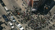Toronto police attempt to surround protestors who moved onto the street at Sherbourne and Dundas, Monday, June 21, 2010.