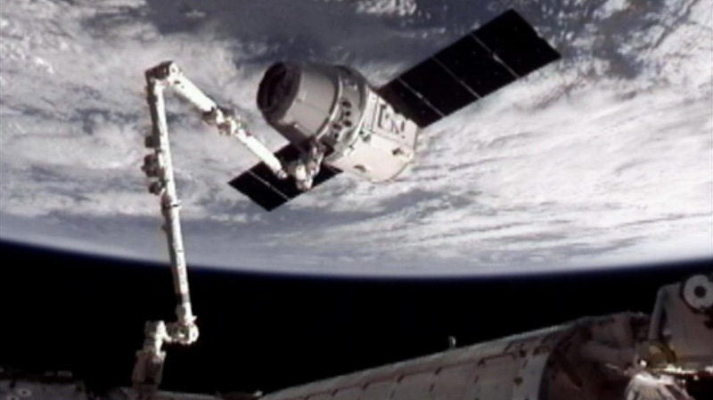 The SpaceX Dragon commercial cargo craft, top, is seen after Dragon was grappled by the Canadarm2 robotic arm and connected to the International Space Station, Friday, May 25, 2012. (NASA)