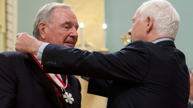 Gov.-Gen. David Johnston invests former prime minister Paul Martin as Companion of the Order of Canada during a ceremony in Ottawa, Friday May 25, 2012. (Adrian Wyld / THE CANADIAN PRESS)