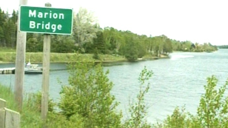 Homeowners spotted a bag with a dead body inside floating on the river on Hillside Road in Marion Bridge, N.S. on Friday, May 25, 2012.