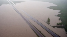Sections of the Trans Canada highway remain closed and some are underwater east of Medicine Hat, Alta., Monday, June 21, 2010. (Jeff McIntosh / THE CANADIAN PRESS)