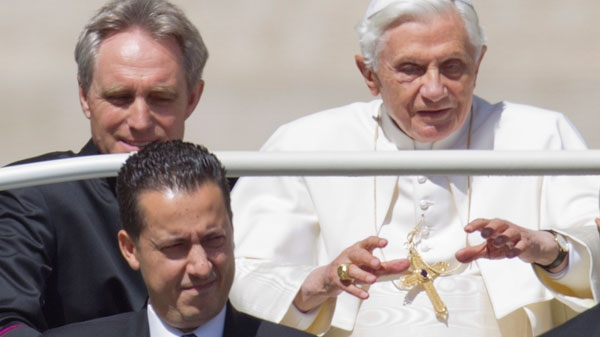 Pope Benedict XVI, flanked by his private secretary Georg Gaenswein, top left, and his butler Paolo Gabiele, arrives at St.Peter's square at the Vatican for a general audience, Wednesday, May, 23, 2012. (AP / Andrew Medichini)