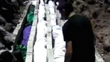 This photo taken from amateur video shows some of the over 90 victims killed in an alleged massacre in the city of Homs, Syria on Saturday, May 26, 2012.