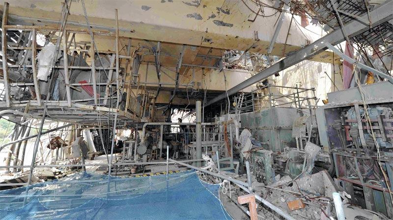 The inside of the tsunami-crippled No. 4 reactor building is seen during a press tour at Tokyo Electric Power Co.'s (TEPCO) Fukushima Dai-ichi nuclear power plant in Okuma, Fukushima Prefecture, Japan, Saturday, May 26, 2012.(AP Photo/ Toshiaki Shimizu, Japan Pool)