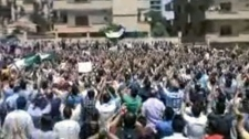 This image made from amateur video shows an anti-government protest in Homs, Syria, Friday, May 25, 2012. (AP / Shaam News Network)