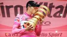 Canada's Ryder Hesjedal kisses the trophy after winning the 95th Giro d'Italia, Tour of Italy cycling race, in Milan, Italy, Sunday, May 27, 2012. (AP / Fabio Ferrari)