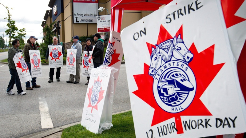 Striking Canadian Pacific Rail workers picket outside the company's Port Coquitlam yard east of Vancouver, B.C., on Wednesday, May 23, 2012. (Darryl Dyck / THE CANADIAN PRESS)