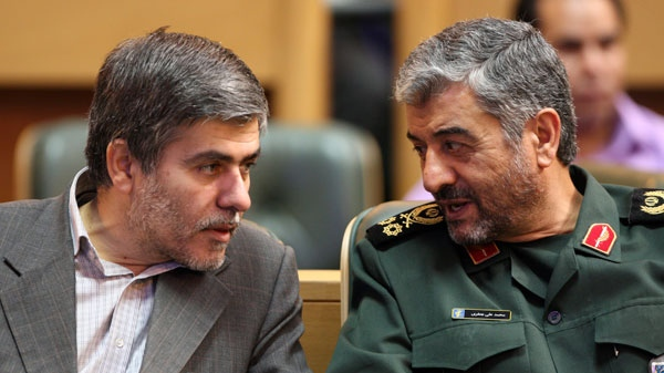 The chief of the Iran's Revolutionary Guard, Gen. Mohammad Ali Jafari, right, talks to head of Iran's Atomic Energy Organization, Fereidoun Abbasi, during a conference in Tehran, Iran, Tuesday, Sept. 6, 2011. (AP / Vahid Salemi)