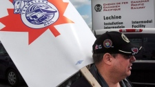Striking Canadian Pacific Rail workers picket outside the company's rail yard in Montreal, Wednesday, May 23, 2012. (Ryan Remiorz / THE CANADIAN PRESS)