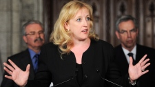 Minister of Labour Lisa Raitt speaks during a press conference in the foyer of the House of Commons on Parliament Hill in Ottawa on Monday, May 28, 2012. (Sean Kilpatrick / THE CANADIAN PRESS)