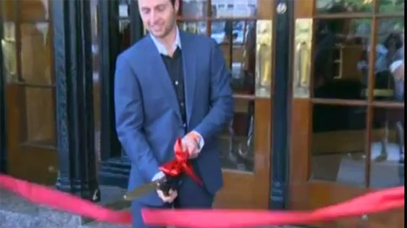 Olympian Alexandre Bilodeau did the honours of cutting the ribbon on the new and improved Ritz Carlton Hotel.