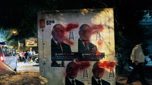 "Defaced posters with Arabic reading ""Egypt is for all, President Ahmed Shafiq"" and pictures of presidential runoff candidate Ahmed Shafiq are seen near his ransacked campaign headquarters in Cairo, Egypt, Tuesday, May 29, 2012. (AP / Nasser Nasser)"