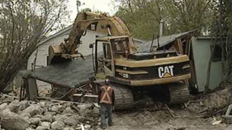 Demolition is underway on cottages at Delta Beach damaged in 2011 flooding in Manitoba.
