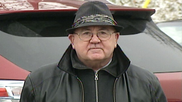 James Boudreau, a retired priest, is seen outside the courthouse in Guelph, Ont. on Jan. 25, 2012.