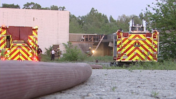 Firefighters deal with a blaze at an empty warehouse in Cambridge, Ont. on Sunday, May 27, 2012.