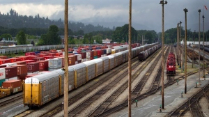 Canadian Pacific Rail locomotives and train cars sit idle at the company's Port Coquitlam yard east of Vancouver, B.C., Wednesday, May, 23, 2012. (Darryl Dyck / THE CANADIAN PRESS)