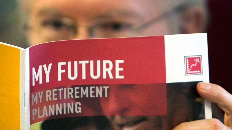 A man looks over a brochure offering various retirement savings options in Montreal, Friday, Feb. 3, 2012.  (Ryan Remiorz / THE CANADIAN PRESS)