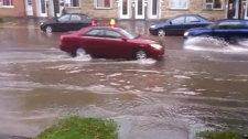 Bob Dubois sent in a video of cars navigating flooded Verdun streets to CTV Montreal MyNews.