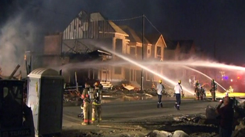 Firefighters shoot water at houses on Mississauga Road and Steeles, Tuesday, May 29, 2012.