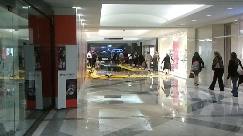 The hallways of Place Ville Marie were soaked following the heavy rains that hit the city.