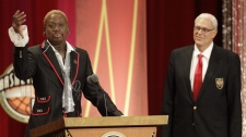 Dennis Rodman delivers his address at his Basketball Hall of Fame enshrinement during a ceremony as his former coach Phil Jackson looks on in Springfield, Mass., Friday, Aug. 12, 2011.