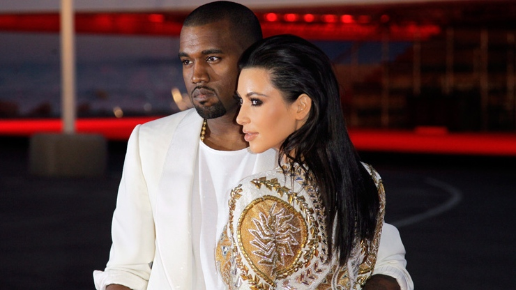 Kanye West and Kim Kardashian arrive for the screening of Cruel Summer at the 65th international film festival, in Cannes, southern France, Wednesday, May 23, 2012. (AP / Francois Mori)