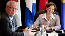 Manitoba Premier Greg Selinger and Alberta Premier Alison Redford take part in the Western Premiers Conference in Edmonton Tuesday, May 29, 2012. (Jason Franson / THE CANADIAN PRESS)