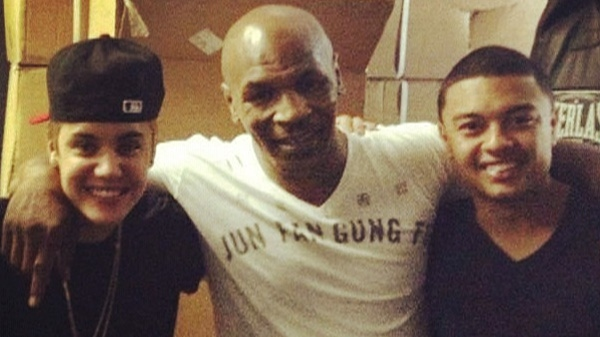 Justin Bieber , Mike Tyson and Alfredo Flores pose for a photo that was posted from Tyson's Instagram account on Monday, May 28, 2012.
