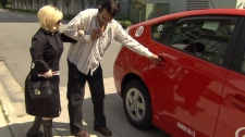 A cab driver helps a client of TransLink's Taxi Saver program. May 30, 2012. (CTV)