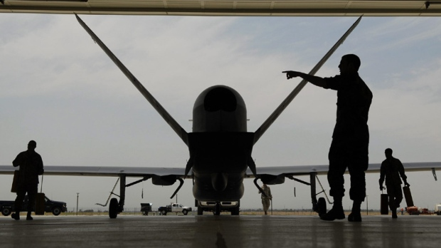 In a Monday, June 30, 2008 photo, Sr. Airman Nicholas Hart helps guides an RQ-4 Global Hawk Block-20 into its hangar at Beale Air Force Base in Yuba County, Calif.
