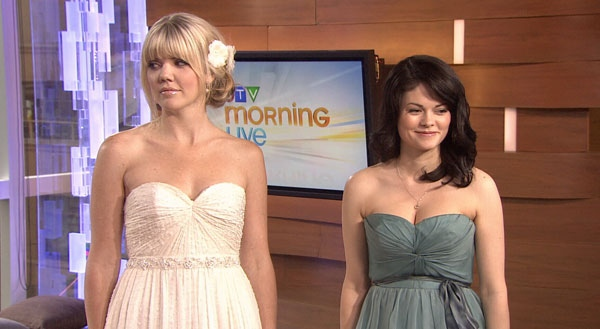 Frocks co-owner Catherine Staveley shows an assortment of bridesmaids dresses. May 30, 2012.  (CTV)