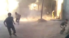 This frame grab made from an amateur video provided by Syrian activists on Monday, May 28, 2012, purports to show the massacre in Houla on May 25 that killed more than 100 people, many of them children. (AP / Amateur Video via AP video)