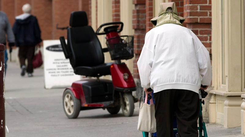 Senior citizens make their way down the a main street in Peterborough, Ont. on Monday May 7, 2012. (Frank Gunn / THE CANADIAN PRESS)