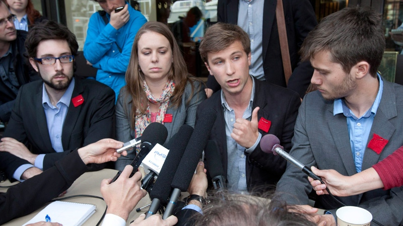 Gabriel Nadeau Dubois of the CLASSE, centre right, responds to reporters questions after negotiations came to a dead-end with Quebec's minister of education at the legislature in Quebec City on Thursday, May 31, 2012. (Jacques Boissinot / THE CANADIAN PRESS)