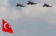 Turkish Air Force fighters fly over a national flag during a ceremony on the Victory Day in Ankara, Turkey, in this Aug. 30, 2007 file photo. (AP Photo/Burhan Ozbilici, File)