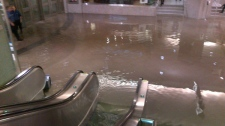 A mixture of rain and sewer water has flooded the concourse of the Royal Bank Plaza in Toronto, Friday, June 1, 2012. (Jeff Long / CTV News)