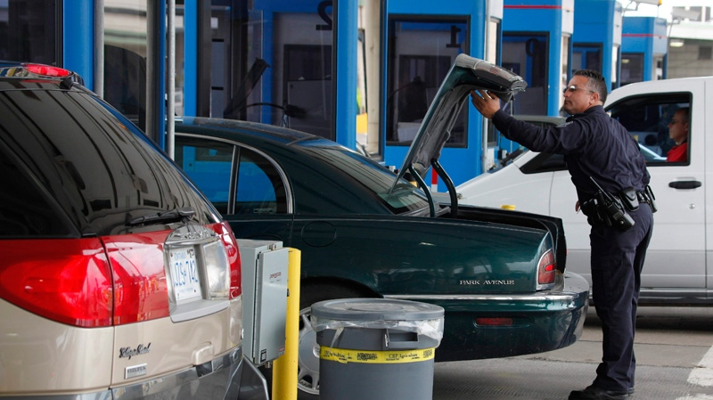 U.S. Customs and Border Patrol officer Jeffery Hill checks the trunk of a motorist's vehicle entering the United States at the Peace Bridge border crossing in Buffalo, N.Y., June 1, 2009. (AP / David Duprey)