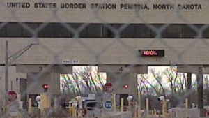 A file image shows a Manitoba-North Dakota border crossing.