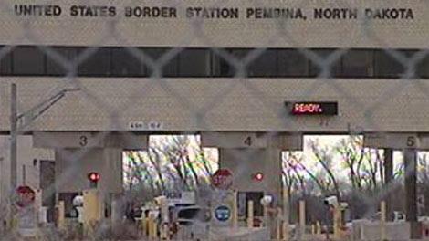 A file image shows a Manitoba-North Dakota border crossing.