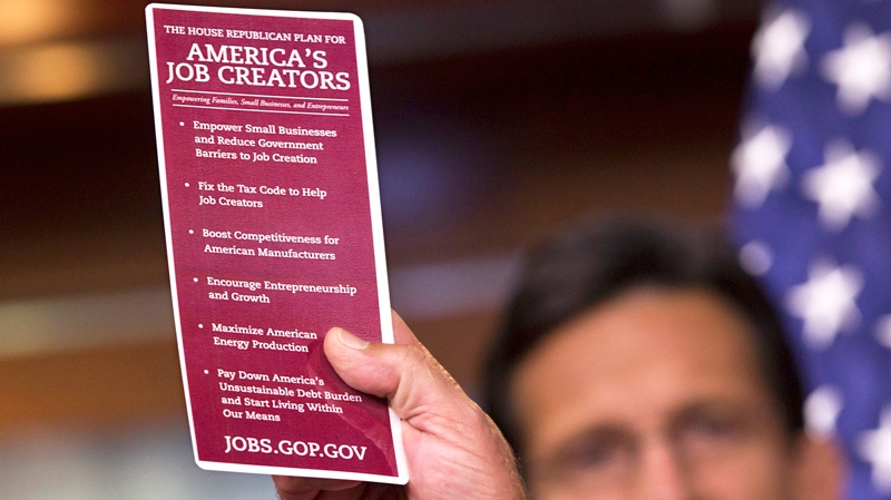 House Speaker John Boehner of Ohio, holds up a laminated card highlighting his plan to create jobs during a news conference on Capitol Hill in Washington, Friday, June 1, 2012. (AP / J. Scott Applewhite)