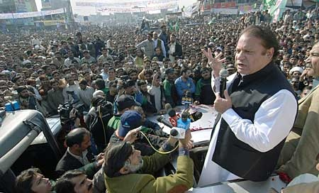 In this photo released by the Pakistan Muslim League, Pakistan's former Prime Minister Nawaz Sharif, right, delivers a speech during an election campaign rally in Patoki near Lahore, Pakistan on Sunday, Dec. 16, 2007. (AP Photo/Pakistan Muslim League)